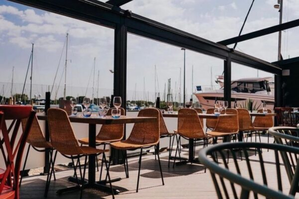 an image showing the outdoor terrace at The Boat House Cafe, Chichester Marina