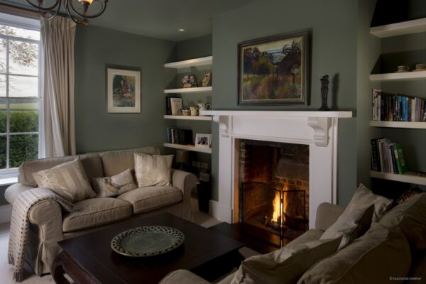 An image showing the fireplace in the lounge at Hunter's Lodge