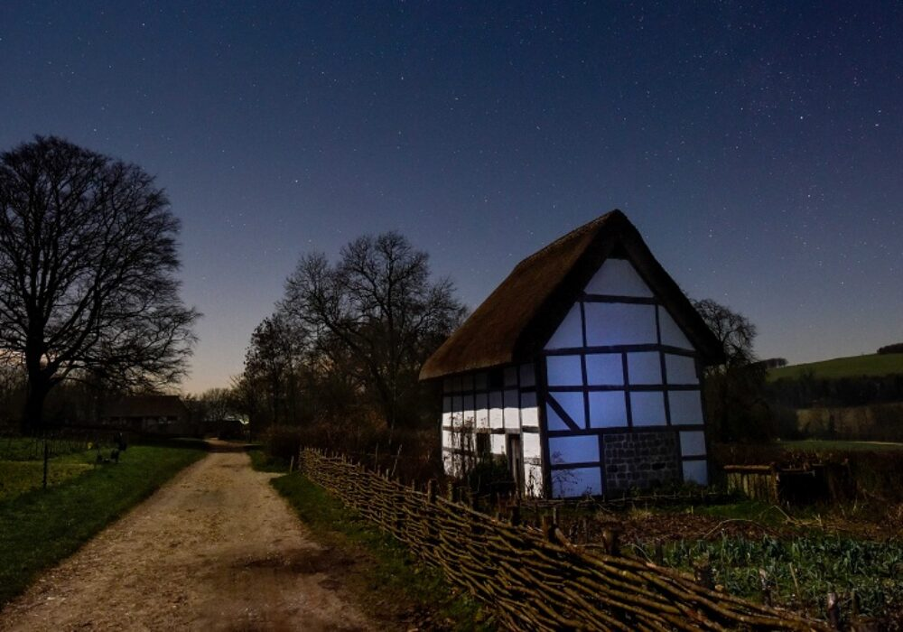 Image of Weald & Downland Living Museum's Poplar Cottage at night