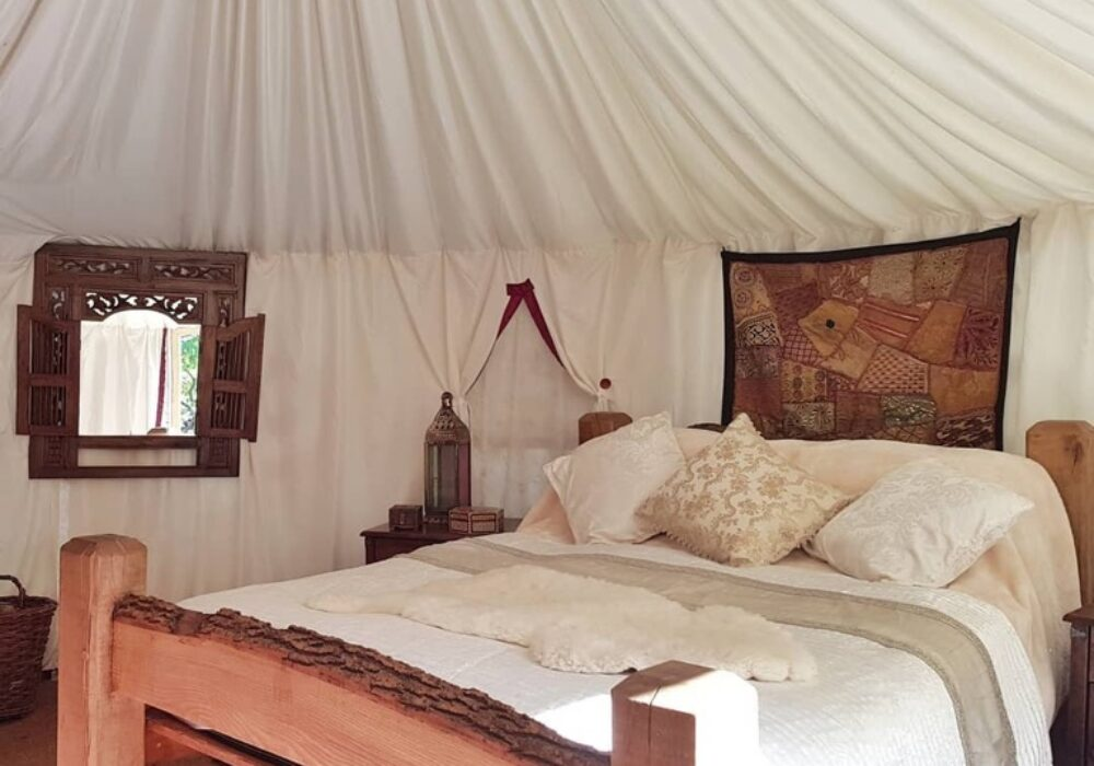 An image showing the interior of a glamping tent at Plush Tents Glamping