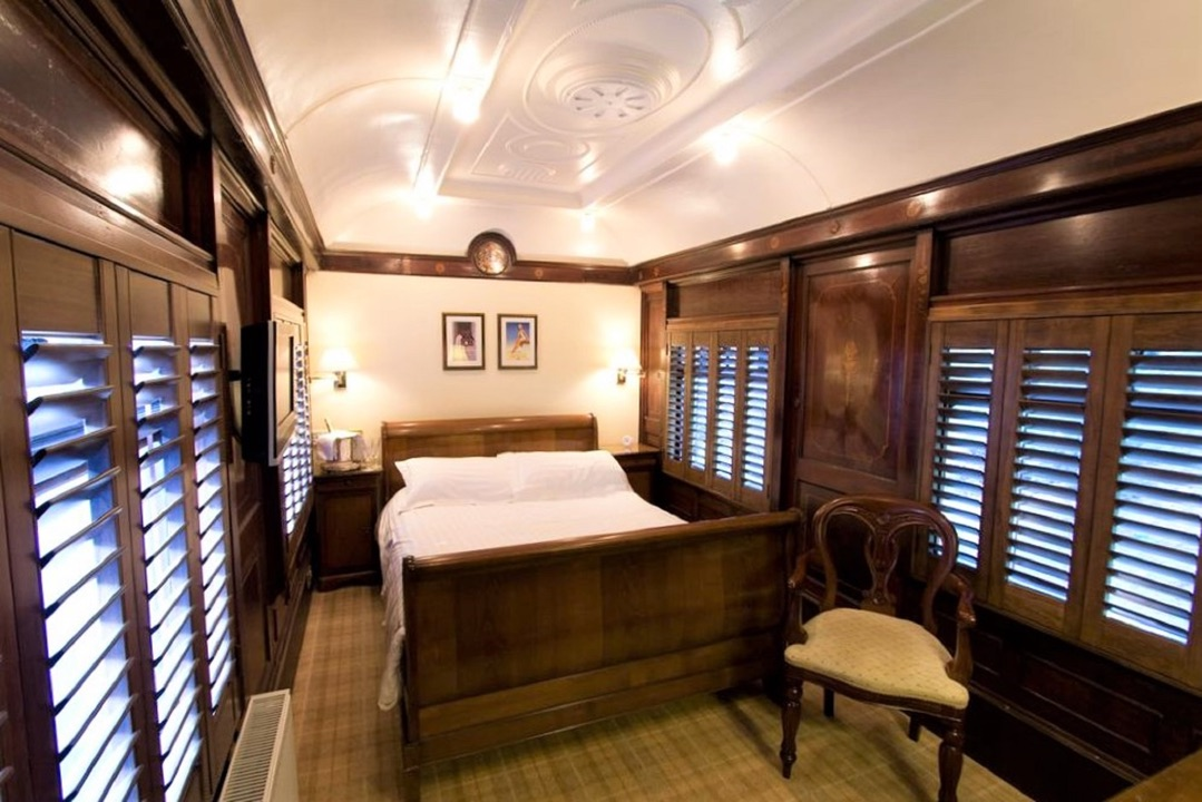 An image showing the interior of a railway carriage bedroom at The Old Railway Station B&B near Petworth