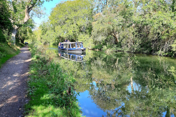 An image showing Chichester Canal with a canal boat, taken by Meryn Woodland