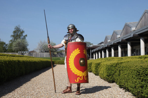 An image showing a person dressed as a Roman Soldier at Fishbourne Roman Palace