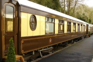 An image showing the exterior of a railway carriage at The Old Railway Station B&B