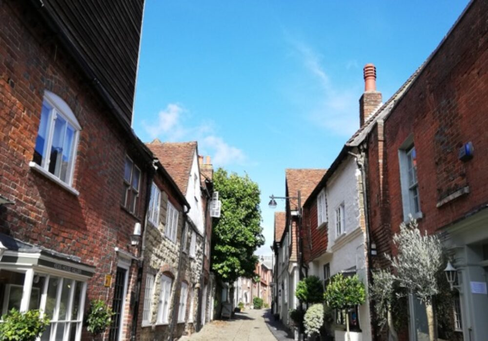 a photo showing a pretty cobbled street in Petworth, West Sussex