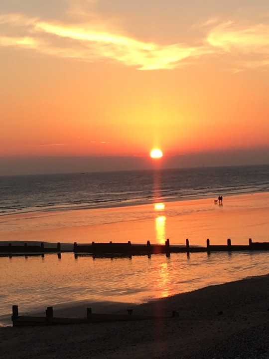 An image showing a sunset at East Wittering Beach in West Sussex