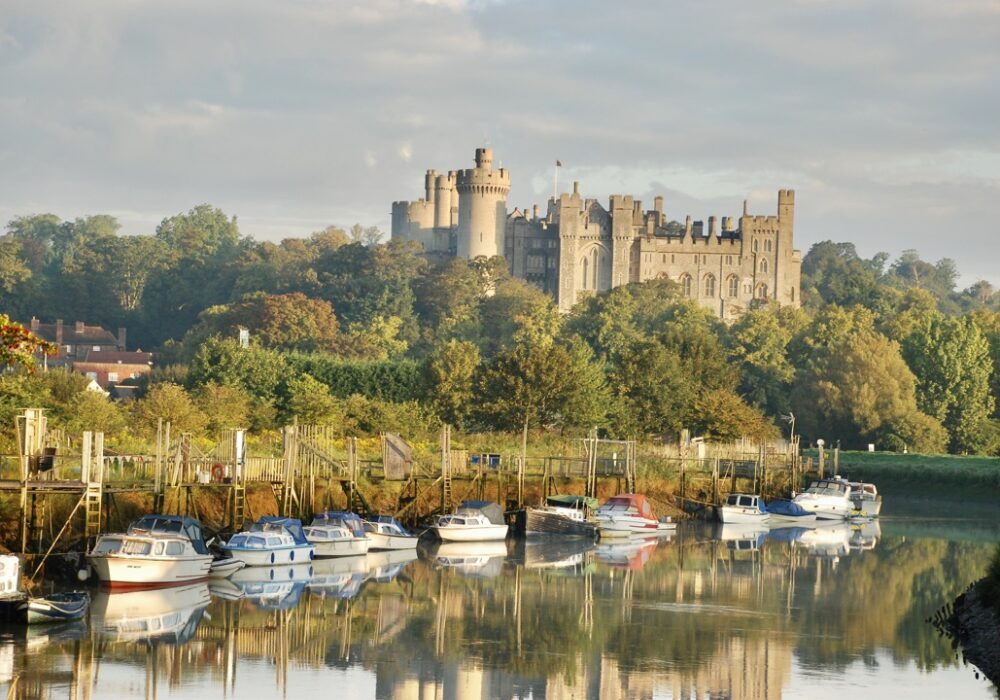 A picture showing a view of Arundel Castle with the River Arun in the background