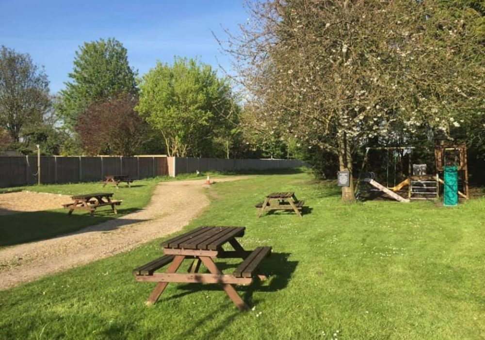 AN image showing the beer garden at The Angelsey Arms