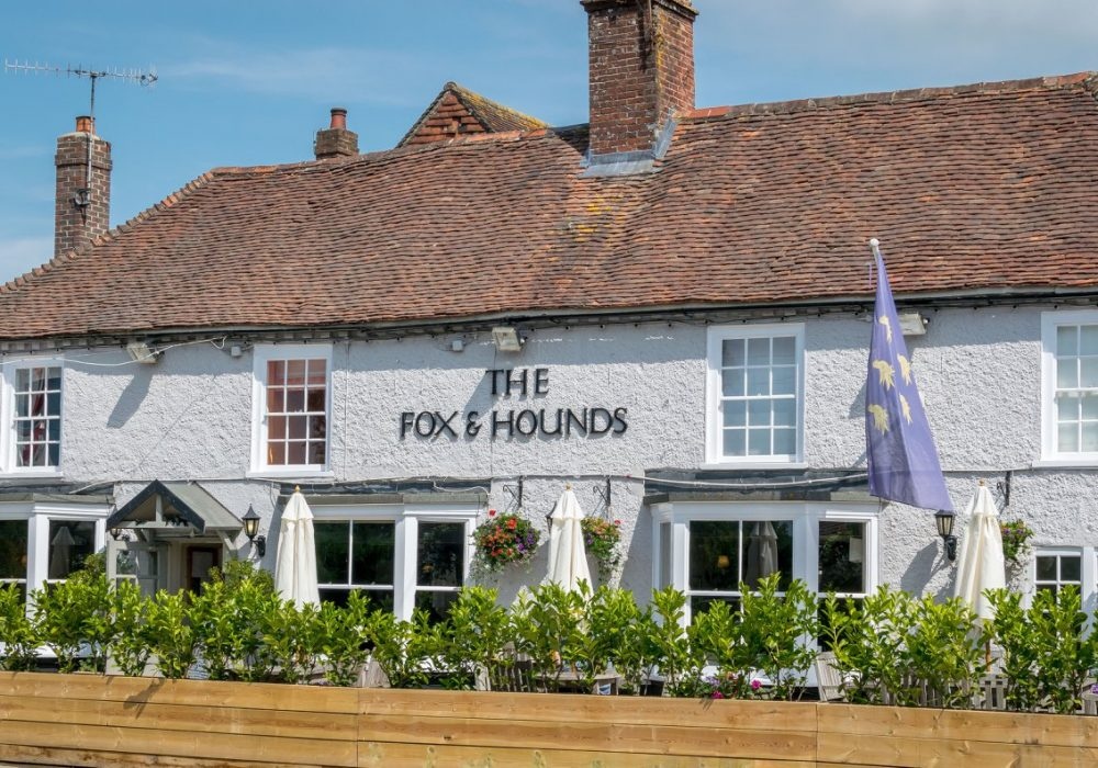 An image showing the Fox & Hounds pub in Funtington, West Sussex