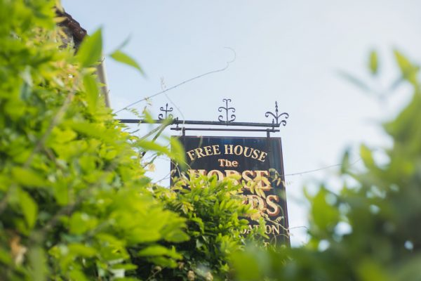 An image showing the pub sign of The Horse Guards Inn, Tillington