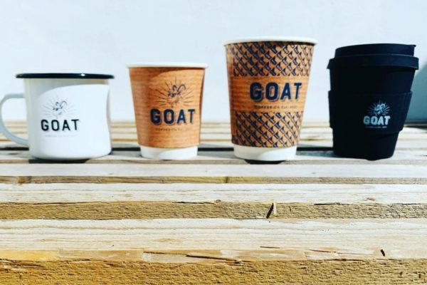 A photograph of coffee cups at GOAT coffee