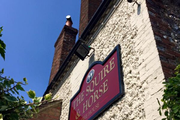 An image of sign at the Squire & Horse pub, Bury